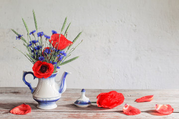 still life with poppies and cornflower
