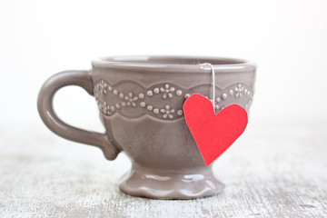 cup with heart shaped tea bag
