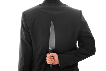 Business man Holding Knife Behind  Back conceptual Isolated