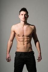 Attractive athletic man with naked torso