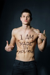 Athletic man with naked torso. Sign Made in Moldova