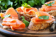 Smoked salmon free canape parsley leaf on wood - 76110474