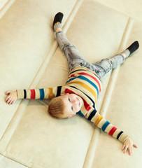 Preschooler boy lying on inflatable mattress