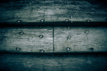Background of the old wooden planks with nails