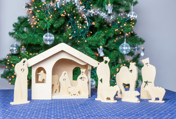 Wooden christmas stable with bible figurines