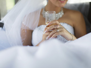 Bride holds wine glass