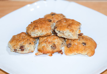 Handmade crisp biscuits with raisin on white plate