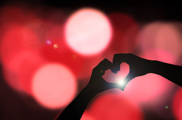Silhouette hand in heart