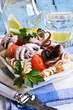 Salad with octopus, pasta and tomato