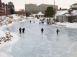 People skate at early evening on a frozen lake