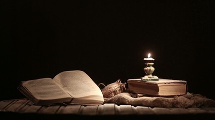 A picturesque scene with a vintage book and candle