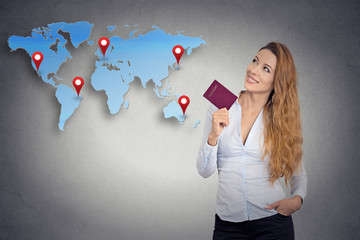 tourist young woman holding passport looking at world map