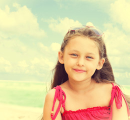 beautiful little girl in sunglasses seaside