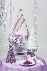 Big New Year's or wedding cake on lightly decorated background.