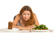 woman deciding whether to eat healthy food or sweet cookies - 76115209