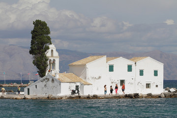 Church and monastery on island. Kanoni, Corfu, Greece
