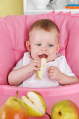 Cute baby eating fruit
