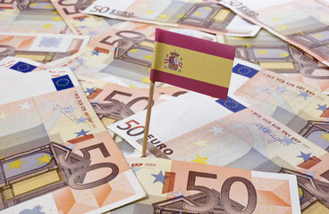 Flag of Spain sticking in 50 Euro banknotes.(series)