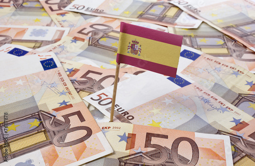 Flag of Spain sticking in 50 Euro banknotes.(series) - 76117878