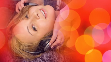 Pretty young woman in headphones listening music background