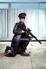 Dark military lady with automatic gun