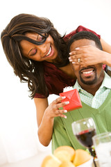Couple: Man Getting Surprised by Gift