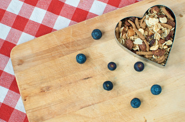Wooden breadboard with blueberries