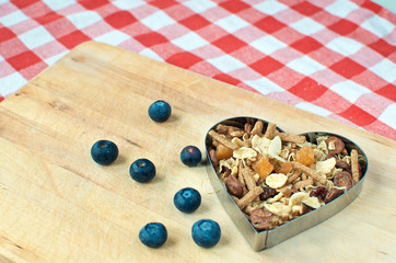 Wooden breadboard with cereal heart
