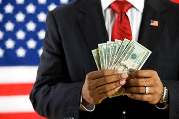 Politician: Holding a Fan of US Currency
