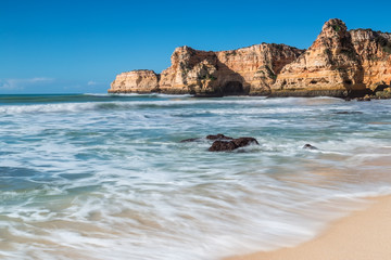 Summer beach with clear water. Albufeira, Portugal.