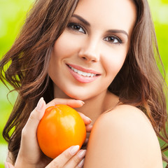 Woman with persimmon fruit