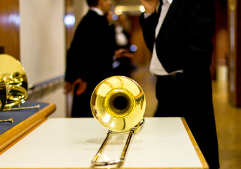 gold trombone behind the scenes. Musical instrument.