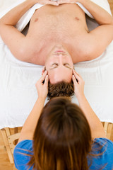 Massage: Overhead View of Man Getting Massage