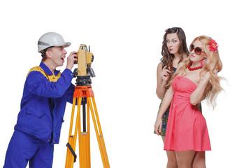 Builder, surveying