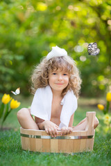 Child bathing outdoors in spring