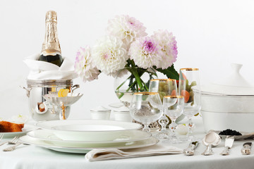 table with dishes and champagne
