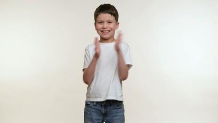 Boy boy claps his hands. White background