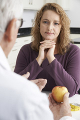 Plus Size Woman In Meeting With Dietitian
