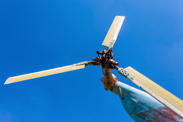 Turbine of russian transport helicopter against blue sky
