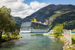 Large luxury cruise ship anchored in fjord and camping cars
