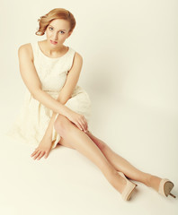young blonde in white dress posing
