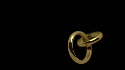 Wedding rings rotating on black background + alpha matte