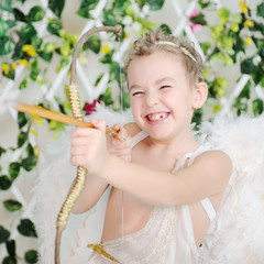 baby cupid shoots a bow