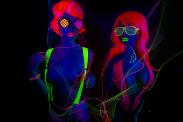 two sexy neon uv glow dancers
