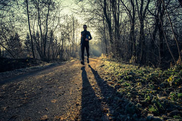 a man trail running in the country