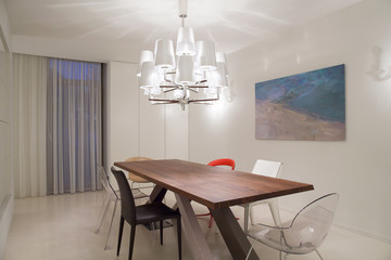 Wooden table inside bright room