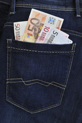 Euro banknotes in jeans