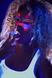 Beautiful curly girl posing in ultraviolet light poster