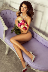 Sensual woman naked with flowers.