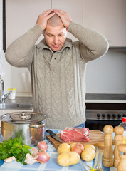Man thinking what to cook for dinner